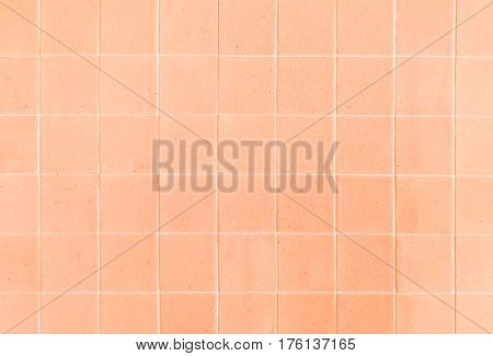 close up background and texture of stretch marks cracked on orange glazed tile