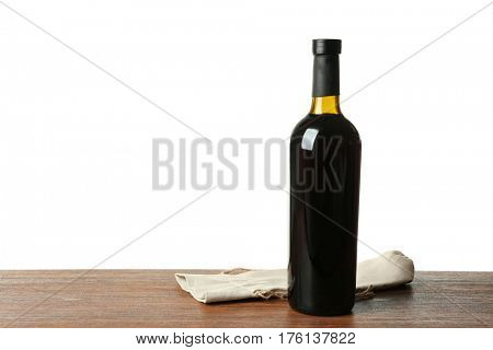 Table with wine bottle on white background