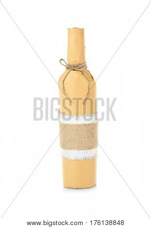 Bottle of wine in paper on white background