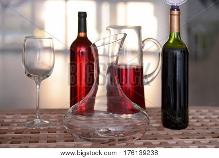 Decanter and glass on table against blurred background