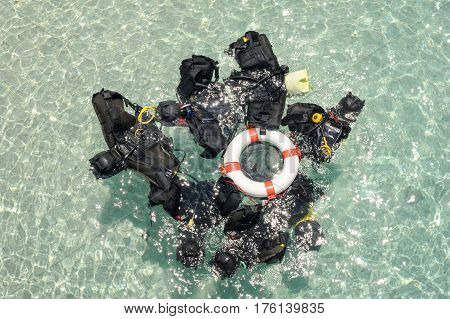 Cala Mariolu, Italy - 28 June 2013:  Scuba diving tank and regulator on the sea
