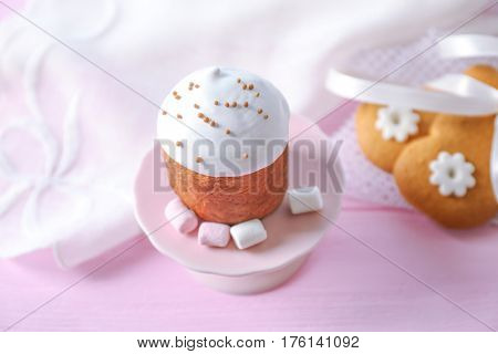 Dessert stand with sweet Easter cake on table