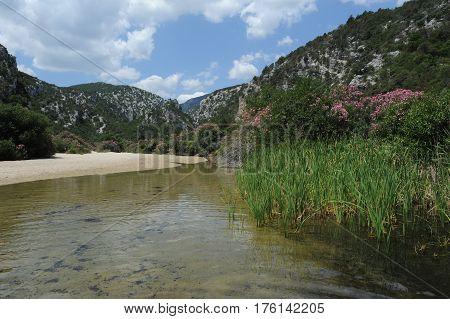 Beach and river of Cala Luna on Sardinia island, Italy