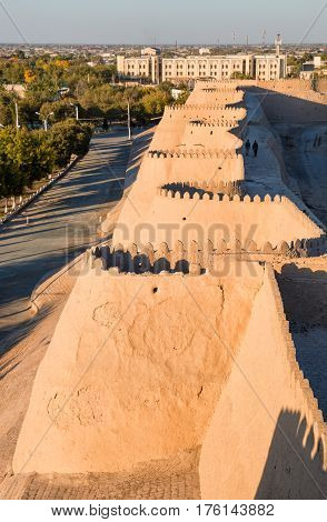 Walls with battlements of the ancient fortress of Ichan-Kala in the city of Khiva Uzbekistan
