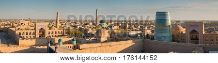 Panoramic view of the ancient fortress Ichan Kala from the observation deck at sunset. Khiva Uzbekistan