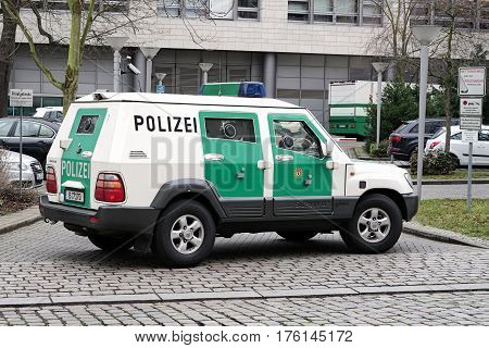 MAGDEBURG, GERMANY - MARCH 07, 2017: Armored police car as escort for a money transport in the inner city of Magdeburg