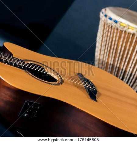 Acoustic Guitar With Percussion Drum
