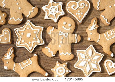 Gingerbread cookies on wooden background close up