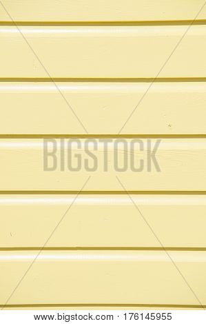 wooden clapboard background of textured siding painted in orange color with horizontal lines and nobody as empty or blank backdrop