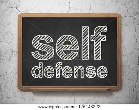 Protection concept: text Self Defense on Black chalkboard on grunge wall background, 3D rendering