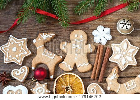 Christmas background with the traditional gingerbread cookies