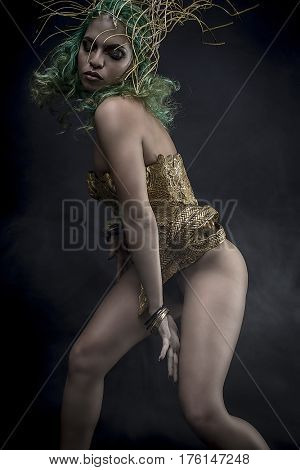Deity, beautiful woman with green hair in golden goddess armor. Fantasy warrior