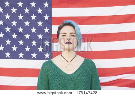 androgynous lesbian woman fighting for equality of gender isolated on a United States of America flag