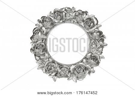 Silver oval picture frame with rose decor, clipping path included.