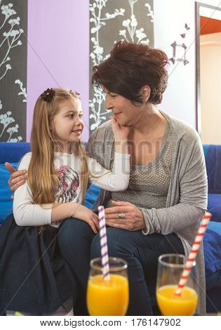 grandma and smiling granddaughter loves spending time together
