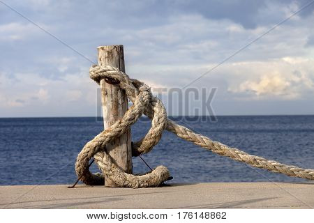 Rope On Seafront And Cloudy Sky In Sun Autumn Day
