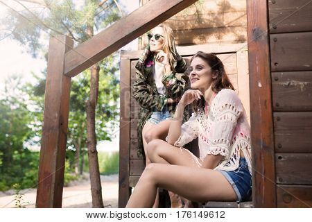 Beautiful Happy Girls In Front Of Wooden Cabinet