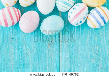 Colorful Easter Eggs on the rustic wooden background. Selective focus.