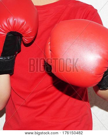 Very beautiful red boxing gloves on the hands