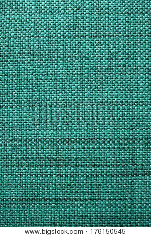 Turquoise fabric texture. Turquoise cloth background. Close up view of turquoise fabric texture and background. Abstract background and texture for designers.