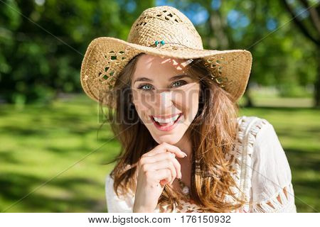 Beautiful Woman In Panama Hat Outside Smiling