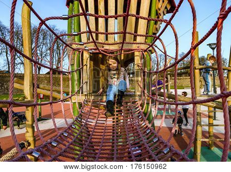 Cute little girl playing on the childre playground Selestat France