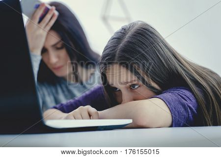 Scared mother arguing daughter over online activity. Cyber bullying or blue whale game concept