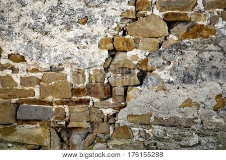 background detail stone wall with plaster subside