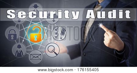 Male corporate consultant in blue shirt and suit is initiating a Security Audit. Corporate and computer security procedures metaphor and information technology concept for a technical assessment.
