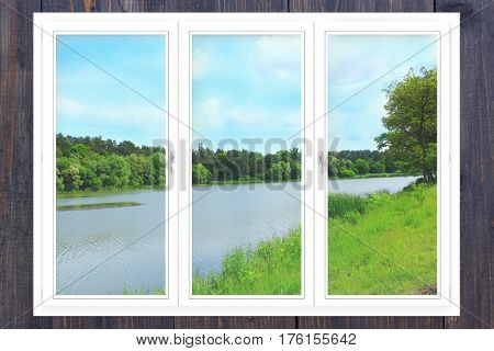 office panoramic windows with view to the beautiful forest river