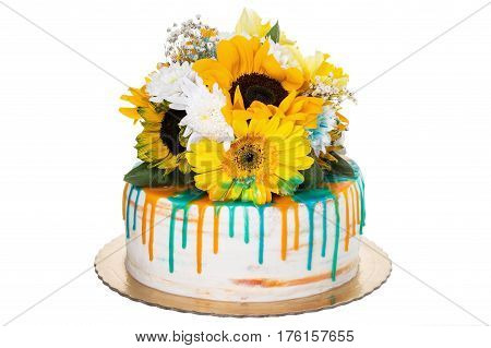 Sunny cheerful birthday cake. From sunflowers on a white background