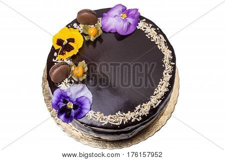 Delicious chocolate cake. With berries Physalis close up
