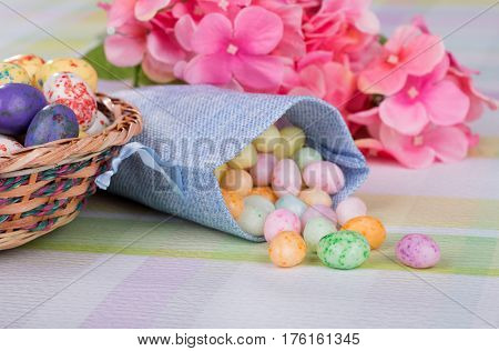 Easter Jelly bean candy in a blue cloth bag on a table
