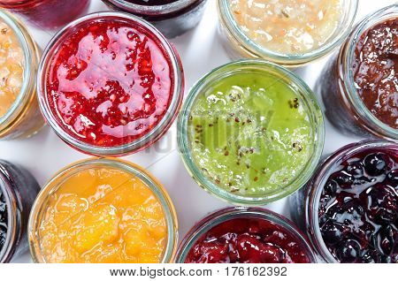 Mix of jams in jars. Homemade fruit jams