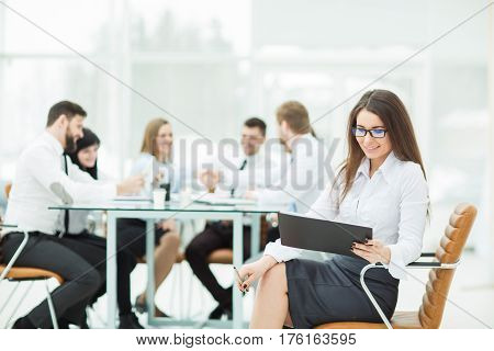 leading lawyer of the company on background, business meeting business partners. the photo has a empty space for your text.