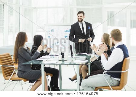 senior Manager of the company and the business team are hosting a discussion on the presentation of a new financial project . the photo has a empty space for your text.