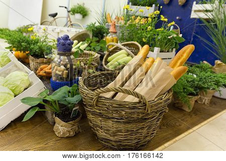 Vegetables and baguettes on a stylized counter. Food