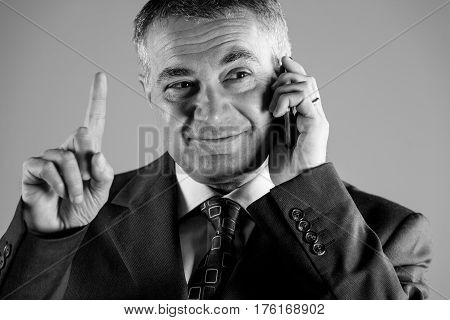 Businessman Gesturing With His Finger