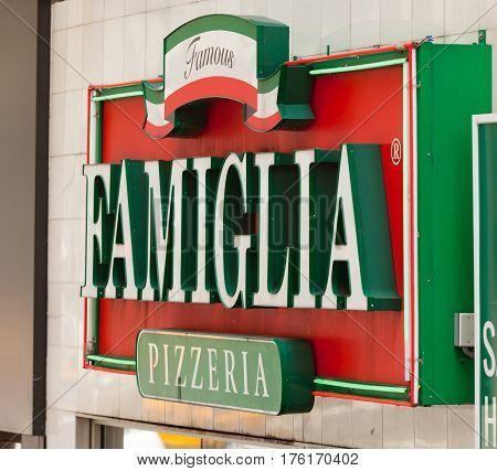 Lighted Sign Of Famous Pizzeria Famiglia In Manhattan