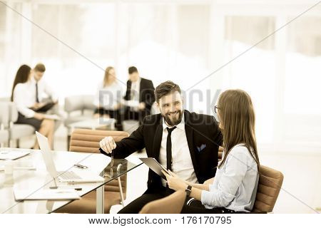 business team performs analysis of marketing reports at the workplace in bright office.the photo has a empty space for your text
