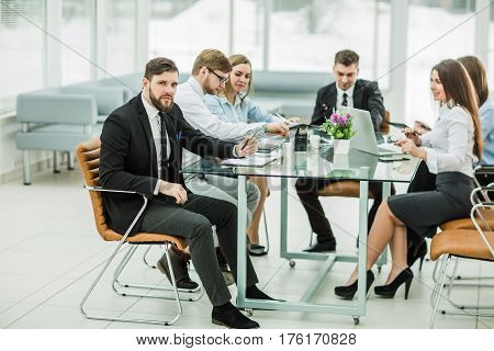 sales Manager and business team are working with financial reports at the workplace in the office.the photo has a empty space for your text