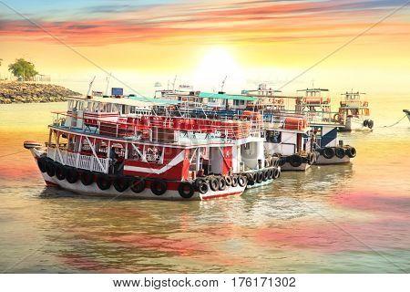 Mumbai, INDIA - December 6 : Tour boats at the coast of Mumbai city, on December 6,2015 Mumbai, India