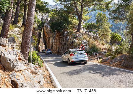 MAJORCA/ SPAIN - JUNE 12, 2016. Mountain road between the rocks along the sea near the village Sa Calobra. Island Majorca, Spain