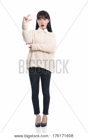 Studio portrait of twenties Asian woman happily having a card