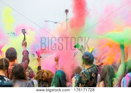Krakow Poland 11 June 2016: Festival of Colors in Krakow. Unidentified people dancing and celebrating during the color throw Poland