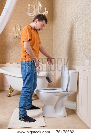 Man drops cell phone in toilet