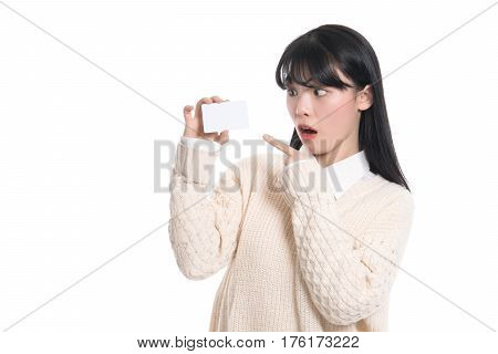 Asian female studio portrait surprised looking at card