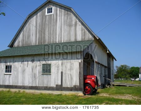 Old Car Sitting In An Old Barn F
