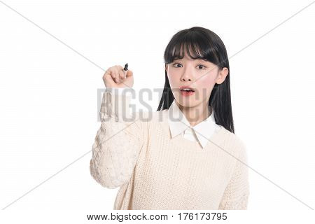 Studio portrait of twenties Asian woman writing something with a pen