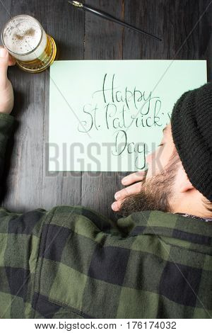 Man Sleeping On A Table With Glass Of Beer